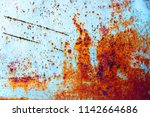 blue iron wall with rust. with... | Shutterstock . vector #1142664686