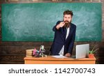 talking to students or pupils.... | Shutterstock . vector #1142700743