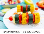 delicious grilled skewers of... | Shutterstock . vector #1142706923