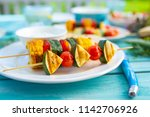 delicious grilled skewers of... | Shutterstock . vector #1142706926
