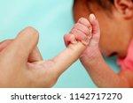 Newborn Baby Boy Gripping...