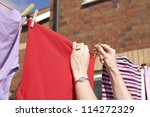 Stock photo pegging out washing to dry on clothes line 114272329