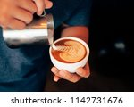 close up barista hands pouring... | Shutterstock . vector #1142731676