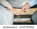 bride and groom holding wedding ... | Shutterstock . vector #1142759060