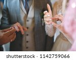 traditional church exchange of... | Shutterstock . vector #1142759066