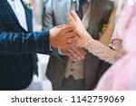 exchange of wedding rings at... | Shutterstock . vector #1142759069