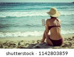 beautiful young female with hat ... | Shutterstock . vector #1142803859