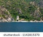 monastery buildings on shore of ... | Shutterstock . vector #1142815370