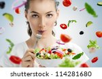 a beautiful girl eating healthy ... | Shutterstock . vector #114281680