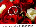 gold wedding rings with red... | Shutterstock . vector #1142835533