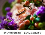 gold wedding rings with flowers.... | Shutterstock . vector #1142838359