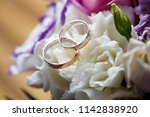 gold wedding rings with flowers.... | Shutterstock . vector #1142838920