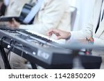 people playing the piano | Shutterstock . vector #1142850209