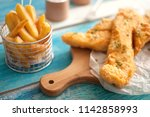two pieces of cod fried in... | Shutterstock . vector #1142858993