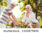 enjoying our retirement... | Shutterstock . vector #1142875850