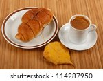 Autumn scene. Coffee and croissant on table - stock photo