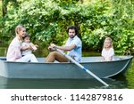 side view of young family... | Shutterstock . vector #1142879816