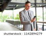 portrait of young handsome... | Shutterstock . vector #1142894279