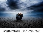 a young farmer sits on a lonely ... | Shutterstock . vector #1142900750