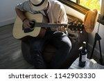 musician playing the guitar   Shutterstock . vector #1142903330