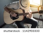musician playing the guitar   Shutterstock . vector #1142903333