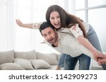 happy couple resting in a... | Shutterstock . vector #1142909273