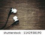 earphone on old wood background....   Shutterstock . vector #1142938190