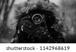 photographer in the cold french ... | Shutterstock . vector #1142968619