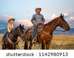 a cowboy and his son on... | Shutterstock . vector #1142980913