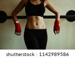 midsection view of sportive... | Shutterstock . vector #1142989586