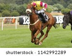 Small photo of More Bucks with all four hooves off the ground gallops to the line and wins the Listed Summer Plate at Market Rasen Races : Market Rasen Racecourse, Lincolnshire, UK : 21 July 2018 : Pic Mick Atkins