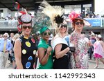 Small photo of A group of fashionable well dressed women pose whilst enjoying the social atmosphere at Market Rasen Races Ladies Day : Market Rasen Racecourse, Lincolnshire, UK : 21 July 2018 : Pic Mick Atkins