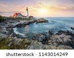 porland head lighthouse at dusk ... | Shutterstock . vector #1143014249