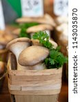 boxes of oyster mushrooms ... | Shutterstock . vector #1143035870