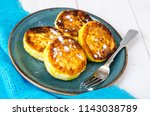 plate with fritters on white... | Shutterstock . vector #1143038789
