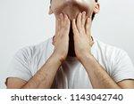 using shaving balm. the man... | Shutterstock . vector #1143042740