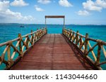 lovely wooden pier leading to... | Shutterstock . vector #1143044660