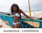 attractive ebony bikini model... | Shutterstock . vector #1143050426