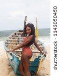 attractive ebony bikini model... | Shutterstock . vector #1143050450
