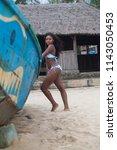 attractive ebony bikini model... | Shutterstock . vector #1143050453