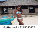 attractive ebony bikini model... | Shutterstock . vector #1143050459