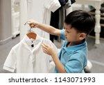 the little asian boy holding... | Shutterstock . vector #1143071993