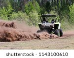 a side by side ripping up dirt... | Shutterstock . vector #1143100610