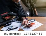business man or gangster hold ... | Shutterstock . vector #1143137456