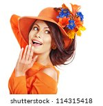 Woman wearing orange hat with flower. Isolated. - stock photo