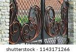 wrought iron gates  ornamental... | Shutterstock . vector #1143171266