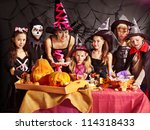 Family On Halloween Party With...