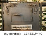 decorated forged steel grill... | Shutterstock . vector #1143219440