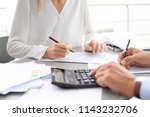 tax accountants working with... | Shutterstock . vector #1143232706