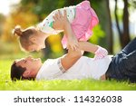 father and daughter in the park | Shutterstock . vector #114326038